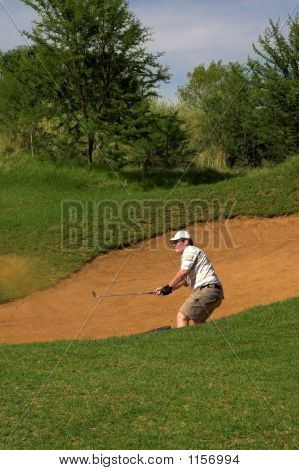 Golfer In The Sand Bunker.