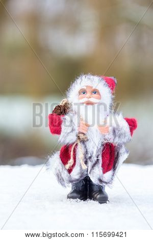 Model Of Santa Claus Standing In White Snow Outdoors
