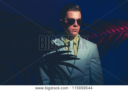 Elegant Man With Shades Standing Like Mannequin