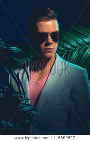 Gorgeous Guy With Shades Standing Between Plants