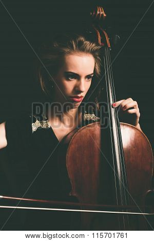 Close Up Pretty Girl Playing A Song On Cello