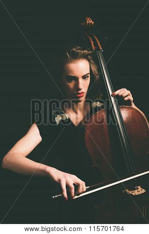 Attractive Young Woman Playing A Cello