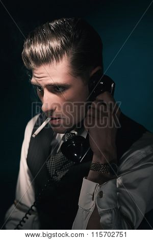 Vintage Stylish Detective In Waistcoat And Tie Calling And Smoking Cigarette. Hair Combed Back. Agai