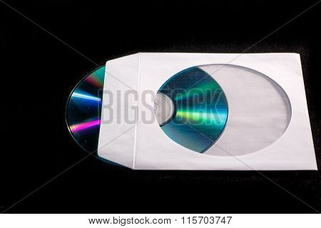 DVD or CD, half inserted in the envelope