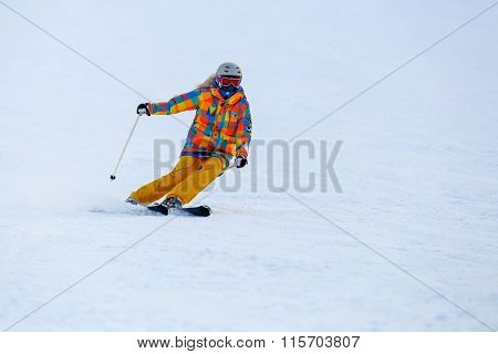 Skier skiing in fresh snow on ski slope