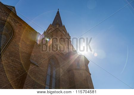 Backlit Shot Of A Steeple With The Sun Behind