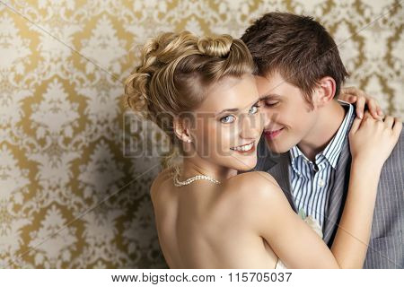 Happy young Bride and groom in studio