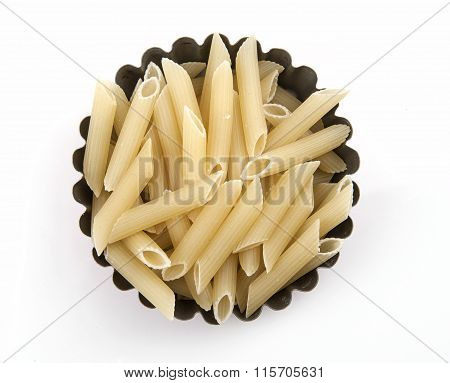 a bowl with raw penne isolated white