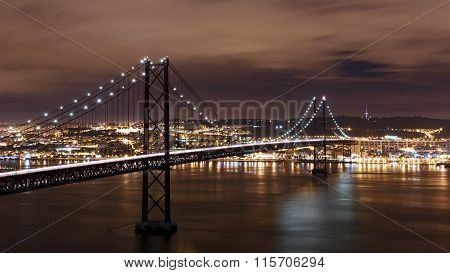Night View Of Lisbon And 25Th Of April Bridge, Portugal