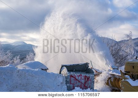 Machinery With Snowplough Blowing The Heavy Snow