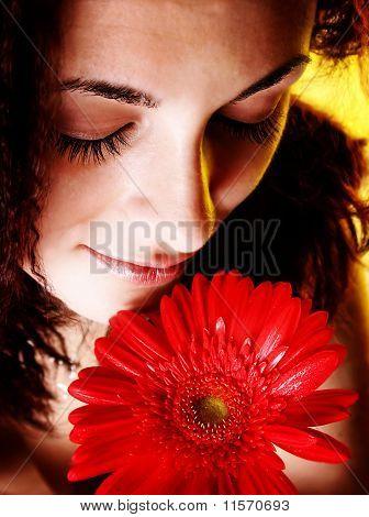 Mädchen mit einer roten Blume