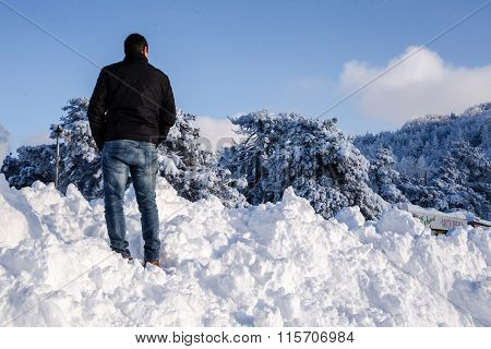 Young Male Looking At Winter Nature