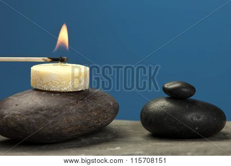 Lighting A Small Candle On Rock.
