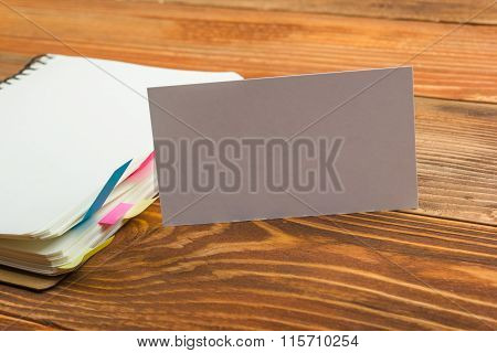 White blank business visit card, gift, ticket, pass, on wooden table.