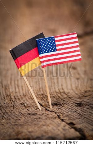 Flags of USA and Germany on wooden background
