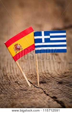 Flags of Spain and Greece on wooden background