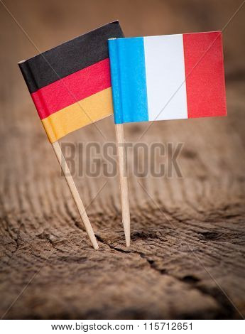 Flags of France and Germany on wooden background