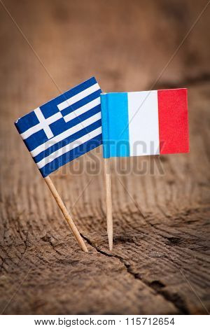 Flags of Greece and France on wooden background