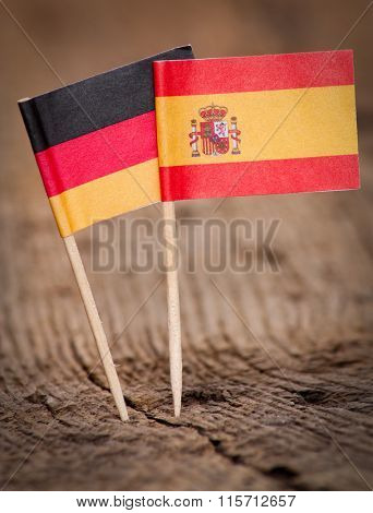 Flags of Spain and Germany on wooden background