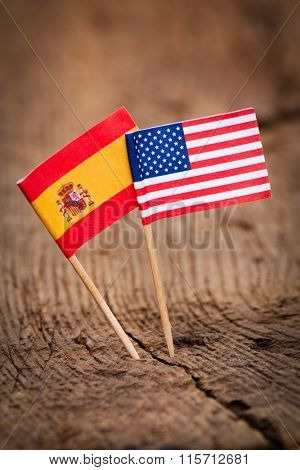 Flags of USA and Spain on wooden background