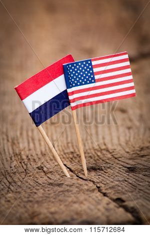 Flags of Netherlands and USA on wooden background