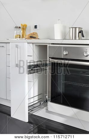 Part Of Modern Kitchen With Electric Stove Oven Details, Drawers, Sink