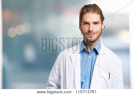 Portrait of an handsome smiling doctor portrait
