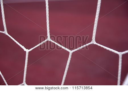 Soccer goal net on red background. Sport theme.