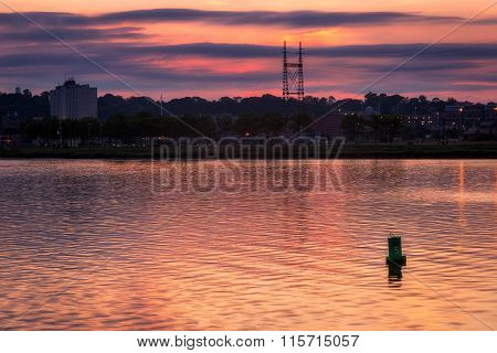 Lone Buoy In Harbor At Sunset