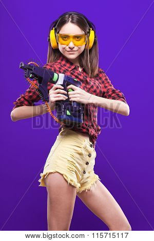 Waist Picture Sexy Girl-builder In Hearing Protection And Protective Glasses Yellow On A Purple Back