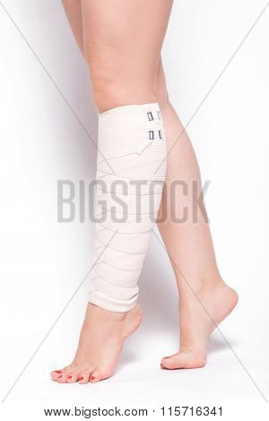 Ankle Woman On A White Background Dragged Elastic Bandage