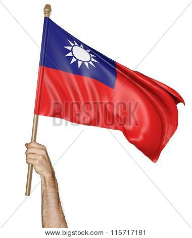 Hand proudly waving the national flag of Taiwan