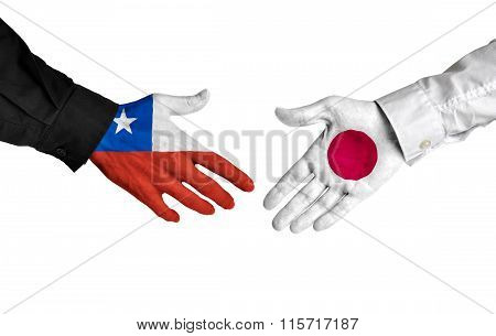 Chile and Japan leaders shaking hands on a deal agreement