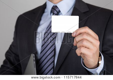 Businessman Holding White Business Card
