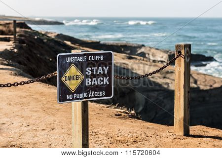 Danger Sign with Fencing at Sunset Cliffs