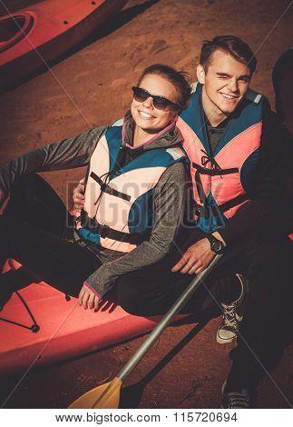 Happy couple on a kayaks