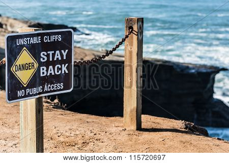 Danger Sign with Railing at Sunset Cliffs