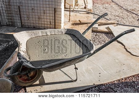 Handcart With Cement On Construction Site