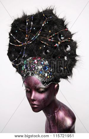 Painted mannequin girl with decorative headwear