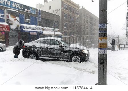 Man Pushes Stuck Vehicle In The Bronx During Snow Storm Jonas
