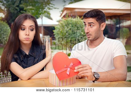 Girl Refusing Heart Shaped Gift From Her Boyfriend