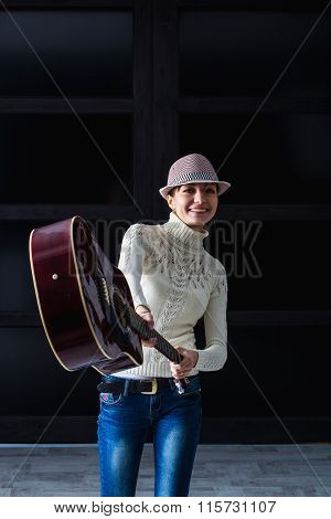 woman brandishing a guitar