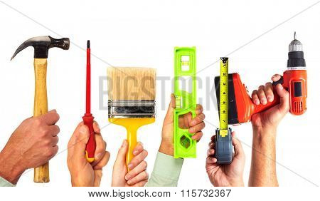Hands of handyman with tools.
