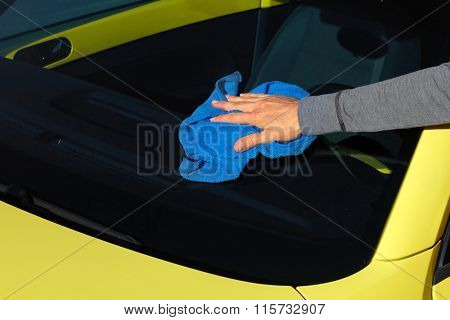 Car with wax and polish cloth.