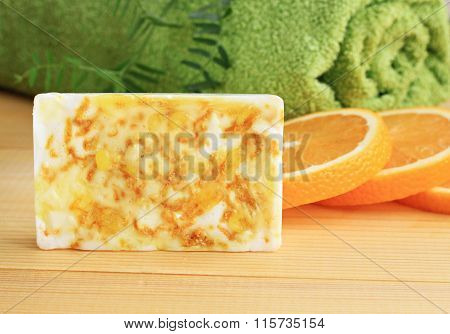 Yellow soap bar with citrus zest