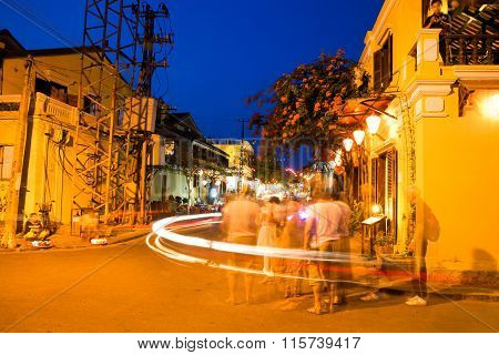 People on the street of Hoi An ancient town with long exposure effect, UNESCO World Heritage Site
