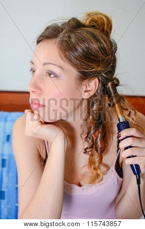 Girl Straightening Her Hair