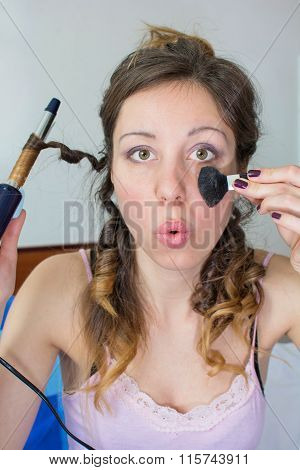 Girl Straightening Her Hair And Putting On Makeup