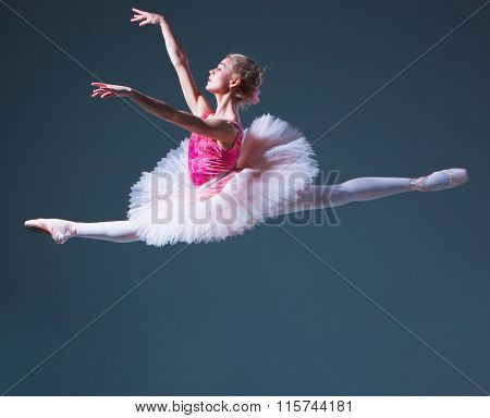 The jump of beautiful female ballet dancer