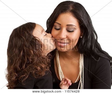 Young Girl Kisses Her Mother